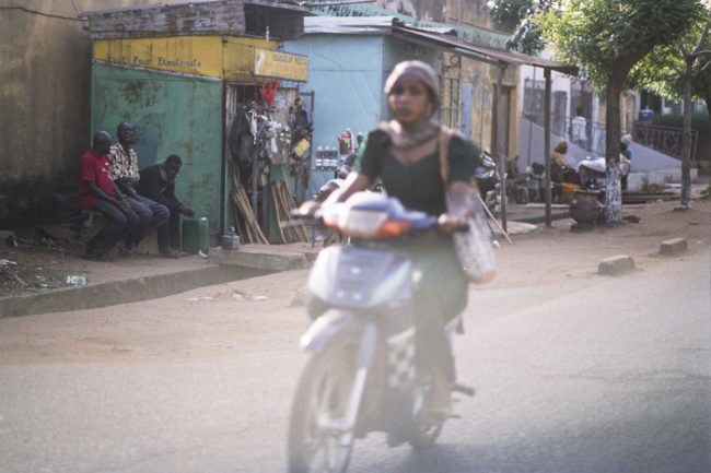 A woman driving in Bamako